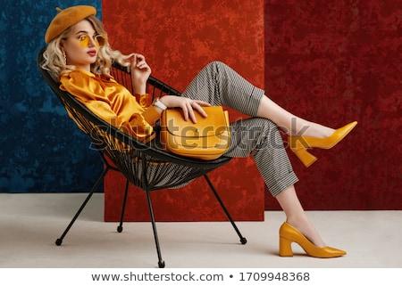 Nő szék fekete ruha felfelé néz izolált fehér Stock fotó © maros_b
