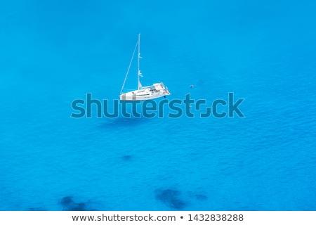 яхта только морем небе воды солнце Сток-фото © gllphotography