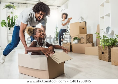 Woman moving in her new house Stock photo © Kzenon