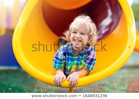 Boy sliding Stock photo © lenm