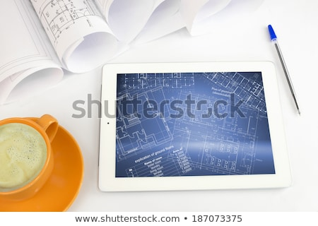 Tablet pc, cup of coffee and scrolls drawings Stock photo © cherezoff