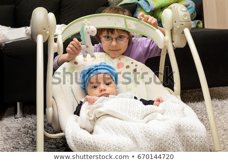 cute newborn baby boy sitting in electrical swing stock photo © anmalkov