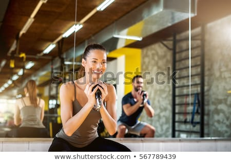 Gym weightlifting couple workout barbell dumbbell  Stock photo © lunamarina