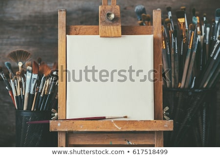 Empty blank canvas in dark room on the wooden easel Stock photo © xura