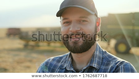 Close Up Of Farmer Working In Organic Farm Field Stock photo © HighwayStarz