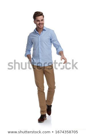 young man laughing while holding his hands in pocket Stock photo © feedough