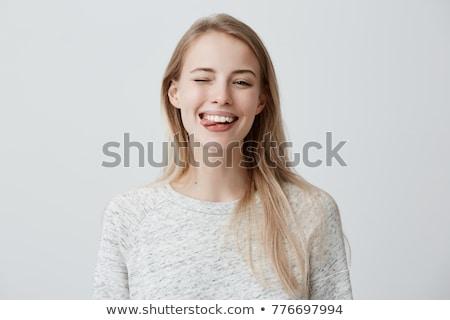 Beautiful young woman blinking eye Stock photo © iko