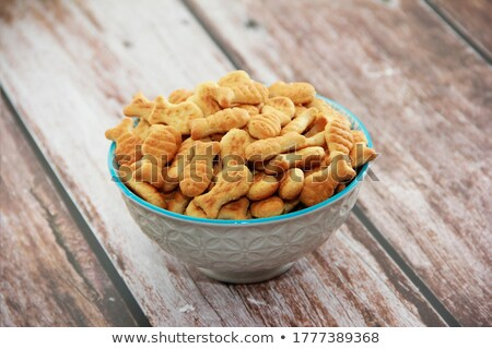 small dried fishes forming a star stock photo © jeancliclac