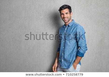 Bonito cara em pé legal masculino Foto stock © phakimata