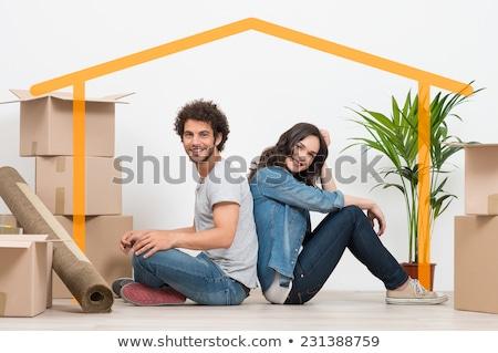 Happy man sitting back after moving in Stock photo © wavebreak_media
