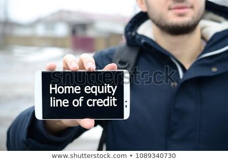 Credit Inscription on the Screen Touch Phone. Stock photo © tashatuvango