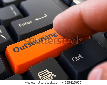 Outsourcing Concept. Person Click Keyboard Button. Stock photo © tashatuvango