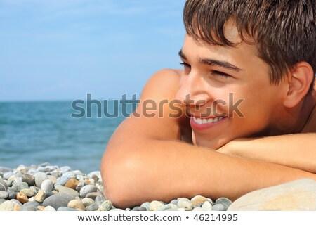 adolescente · menino · olhando · água · sorrir · oceano - foto stock © Paha_L