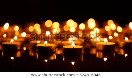 Muitos ardente velas preto fogo fundo Foto stock © vlad_star