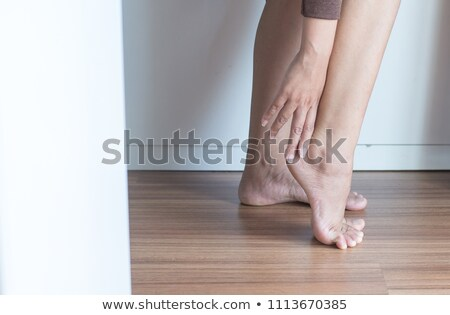 Ballerina having pain in ankle Stock photo © deandrobot