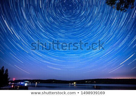 night sky with norther lights with tree silhouettes stock photo © kjpargeter