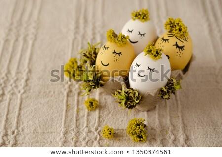Quattro colorato easter eggs tovaglia vernice Foto d'archivio © simply