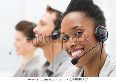 Afro american businesswoman working in call center Stock photo © deandrobot