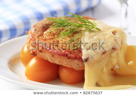 Stock photo: Marinated pork chop topped with cheese