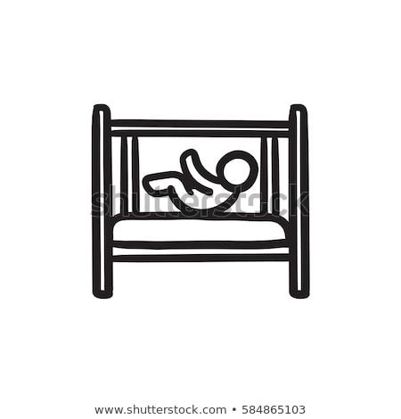 Baby laying in crib sketch icon. Stock photo © RAStudio