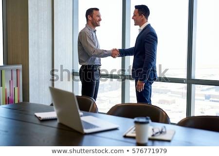 iki · ortaklar · anlaşma · el · sıkışmak · ayakta · ofis - stok fotoğraf © deandrobot