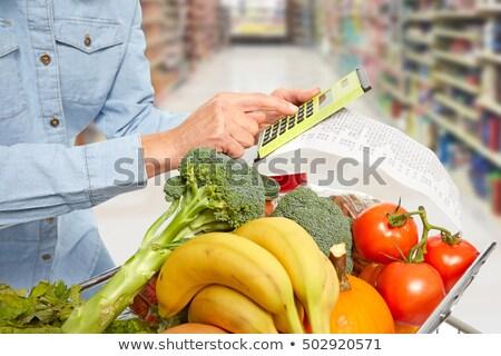 élelmiszer · nyugta · felismerhetetlen · nő · világoskék · póló - stock fotó © kurhan