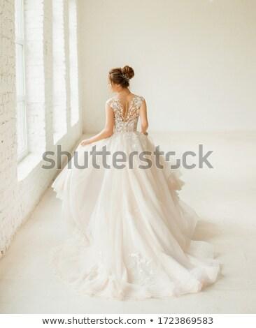 Beautiful brunette woman as bride on white background Stock photo © artfotodima
