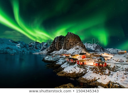 Northern lights over lake in finland Stock photo © Juhku