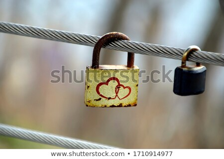 Old keys hang next to the lock Stock photo © Phantom1311