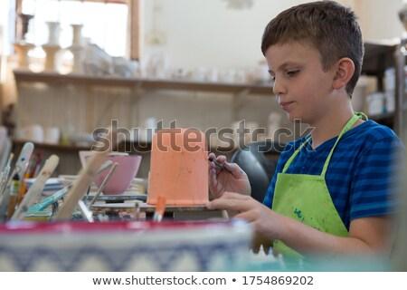 Fiú festmény tál cserépedények bolt figyelmes Stock fotó © wavebreak_media