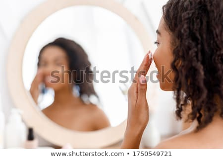 woman with cream applied to shoulder Stock photo © LightFieldStudios