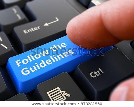 Finger Presses Blue Keyboard Button Training and Development. Stock photo © tashatuvango