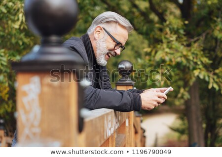 man leaning over on railing Stock photo © IS2