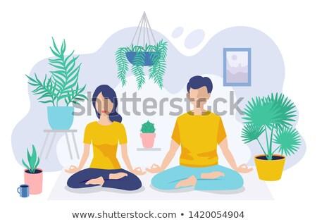 Man meditating in greenhouse in garden Stock photo © IS2