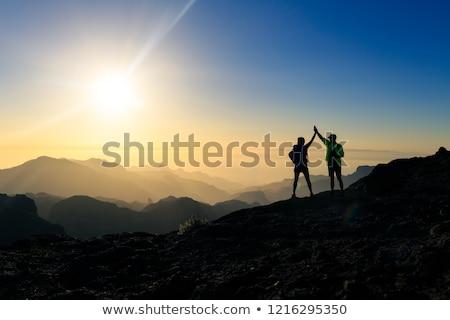 Stock photo: Teamwork couple climbing and reaching mountain peak