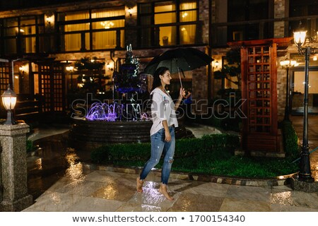 Pretty girl at rainy night outdoors Stock photo © Anna_Om