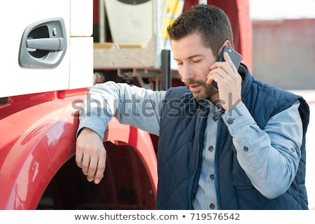 Truck driver talking to worker Stock photo © IS2
