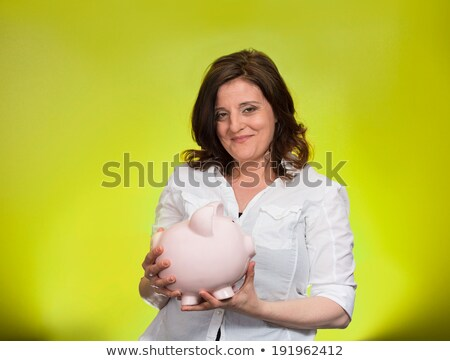 Stock photo: golden egg and canadian dollars