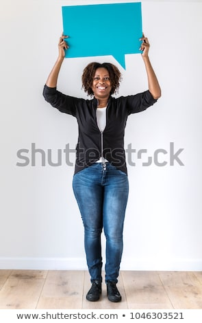 Woman carrying a notice, smiling Stock photo © IS2