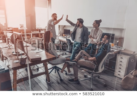 happy creative team celebrating success at office stock photo © dolgachov