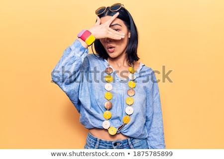 Megrémült barna hajú nő lezser ruházat napszemüveg Stock fotó © deandrobot
