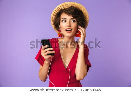 Image of young brunette woman 20s in straw hat and earphones lis Stock photo © deandrobot