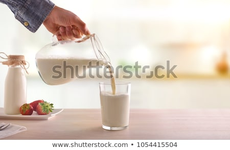 fresh dairy products on white table background glass of milk bowl of flour and cottage cheese and stock photo © denismart