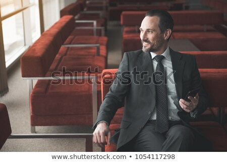 relaxed elegant man sitting looks to side stock photo © feedough