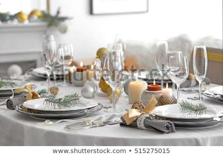 Stock photo: Christmas table setting with candles and xmas gift