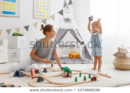 boys playing toy cars in kids tent at home Stock photo © dolgachov