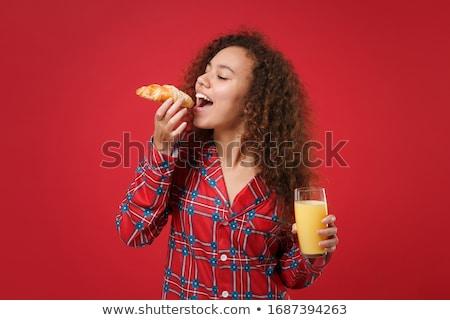 Cabelos cacheados menina adolescente fresco croissant retrato Foto stock © boggy
