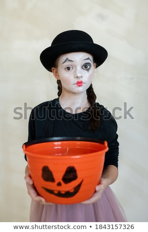 Serious witch looking camera with scary make up Stock photo © deandrobot