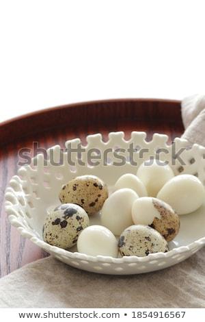Quail eggs on linen background stock photo © furmanphoto