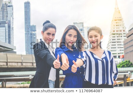 People Hand Showing Thumb Up Sign Against Black Backdrop Stock photo © AndreyPopov